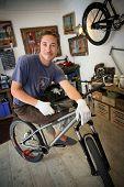 Portrait of smilng craftsman in bike workshop