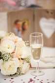 Bride's Bouquet And Glass Of Champagne On Wedding day