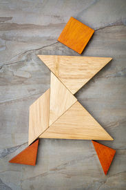 pic of tangram  - abstract of a dancing or walking figure built from seven tangram wooden pieces - JPG