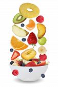 picture of fruit bowl  - Flying ingredients for fruit salad with fruits like apples oranges kiwi peach banana and strawberry in bowl - JPG