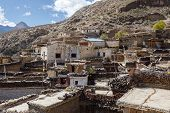 picture of mustang  - Rooftop view over Marpa village - JPG
