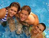 picture of family fun  - Three happy young adults enjoying themselves in the pool - JPG
