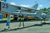 Boy plays with rocket for military airplane