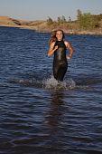 Woman Running Wet Suit