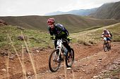 Hard Bike Competition In Mountains