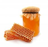 stock photo of honeycomb  - Honey and honeycomb closeup on a white background - JPG