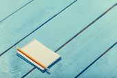 Notebook With Pencil On Blue Wooden Table