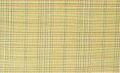 Light brown guncheck pattern on fabric.