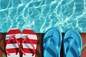 Two Pairs of flip flops by pool