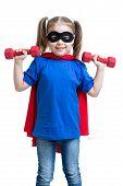 kid girl plays superhero and lifts dumbbells