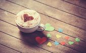 Cup With Coffee And Heart Shape Papers On Wooden Table.