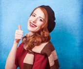 foto of beret  - Redhead women in beret on blue background.
