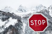 high mountains and stop sign