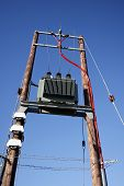 stock photo of substation  - Electric transformer substation against a blue sky - JPG