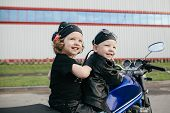 pic of biker  - cute little bikers on road with motorcycle - JPG