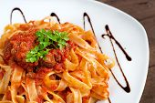 stock photo of boar  - Tagliatelle with wild boar ragu made in italian style - JPG