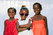 African Girl Wearing Fun Shades With Friends.
