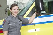 foto of paramedic  - Paramedic employee with ambulance in the background - JPG