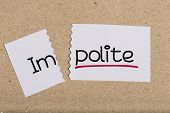 picture of politeness  - Two pieces of white paper with the word impolite turned into polite - JPG