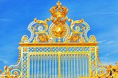 stock photo of versaille  - Golden Gate of Chateau de Versailles with blue sky  - JPG