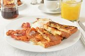 stock photo of french toast  - French toast with bacon and a fried egg - JPG
