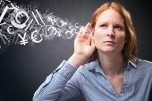 Businesswoman Listens To Financial Data