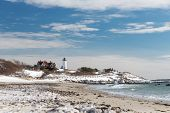 stock photo of coast guard  - Nobska Lighthouse in Cape Cod on a snowy Winter day - JPG