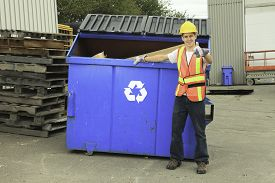 stock photo of bio-hazard  - A worker who recycling thing on recycle center - JPG