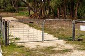 picture of chicken-wire  - Double gate on a drive entering an undeveloped property - JPG