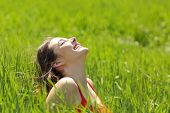 image of breathing exercise  - Happy girl face breathing fresh air and enjoying the sun in a meadow in a summer sunny day - JPG