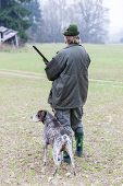 picture of hunt-shotgun  - hunter with his dog hunting - JPG