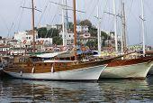 stock photo of mast  - Pair two mast sailing boats at pier - JPG