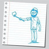 stock photo of selfie  - Hipster man taking selfie holding selfie stick - JPG