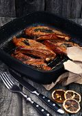 stock photo of flank steak  - Grilled steak on the vintage pan on the old wooden background - JPG