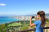 image of waikiki  - Hawaii tourist taking photo of Honolulu and Waikiki beach using smartphone camera - JPG