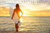 picture of hawaiian girl  - Surfing surfer girl looking at ocean beach sunset - JPG
