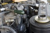 image of differential  - Closeup of a car engine repair indoor shot with a shallow depth of field - JPG
