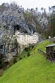 image of cave  - The beautiful view of Predjama Castle in Postojna Cave Slovenia - JPG