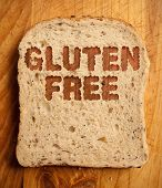 pic of wheat-free  - Gluten free text etched into a slice of bread - JPG