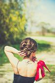 image of barefoot  - Barefoot brunette girl outdoor with red high heels in her hands  - JPG