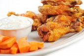 pic of chicken wings  - A dish of chicken hot wings and carrots with dipping sauce - JPG