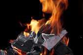 foto of firewood  - Burning Firewood With Sparks And Glowing Coals Close - JPG