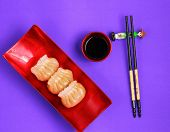 picture of siomai  - Vietnam style steamed shrimp dumplings served on a purple background - JPG