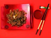 picture of stir fry  - Vietnamese beef stir fry served on a red background - JPG
