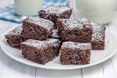 pic of brownie  - Sugar powdered homemade brownies on the plate - JPG
