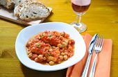 foto of cod  - Salt cod with chickpeas and tomatoes Roman - JPG