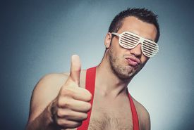 picture of gesture  - Happy guy gesturing thumbs up at sign i feel good - JPG