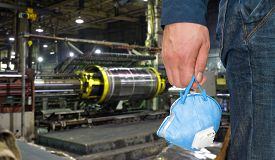 image of respirator  - Worker with protective respirator at man hands at industrial factory - JPG