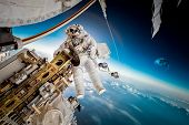 International Space Station and astronaut in outer space over the planet Earth. Elements of this ima poster