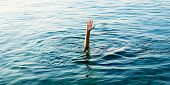 hand of man in ocean